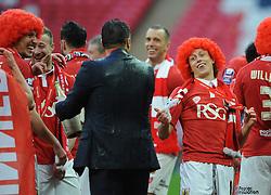 Bristol City's Luke Freeman jokes with Bristol City manager, Steve Cotterill after he gets soaked in champagne  - Photo mandatory by-line: Dougie Allward/JMP - Mobile: 07966 386802 - 22/03/2015 - SPORT - Football - London - Wembley Stadium - Bristol City v Walsall - Johnstone Paint Trophy Final