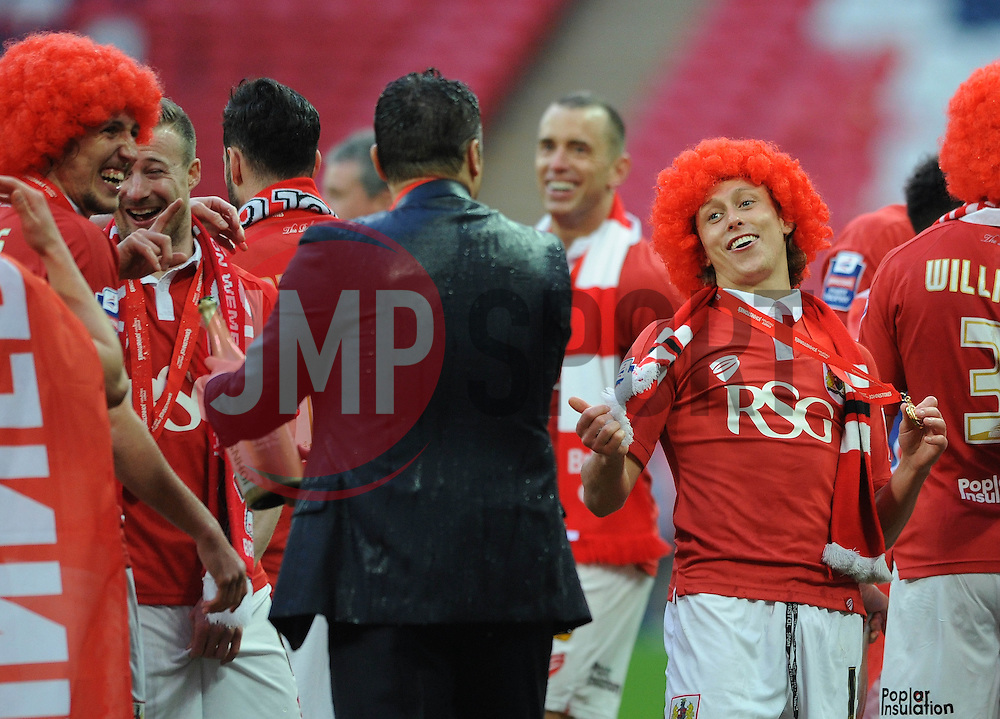 Bristol City's Luke Freeman jokes with Bristol City manager, Steve Cotterill after he gets soaked in champagne  - Photo mandatory by-line: Dougie Allward/JMP - Mobile: 07966 386802 - 22/03/2015 - SPORT - Football - London - Wembley Stadium - Bristol City v Walsall - Johnstone Paint Trophy Final