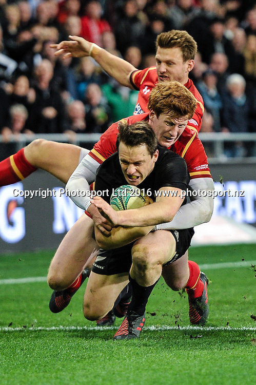 Ben Smith of the All Blacks is tackled by Rhys Patchell of Wales and Dan Biggar of Wales during the 3rd Steinlager Series Rugby Union Test match, All Blacks v Wales, at Forsyth Barr Stadium, Dunedin, New Zealand. 25th June 2016. Copyright Photo: John Davidson / www.photosport.nz
