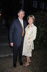 BILL & BIDDY CASH at a Summer party hosted by Lady Annabel Goldsmith at her home Ormeley Lodge, Ham, Surrey on 14th July 2009.