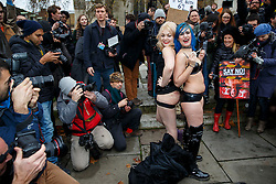 © Licensed to London News Pictures. 12/12/2014. LONDON, UK. Demonstrators simulating sex acts to protest against the proposed restrictions on British producers of online porn, which bans actions such as spanking, facesitting, physical restraint and female ejaculation being filmed, outside Houses of Parliament in London on Friday, 12 December 2014. Photo credit : Tolga Akmen/LNP