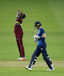 West Indies' Andre Russell celebrates taking the wicket of ICC Rest of the World XI Sam Billings during the special fundraising T20 International match at Lord's, London.