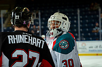 KELOWNA, CANADA - JANUARY 4:  Rhett Rhinehart #27 of the Prince George Cougars stands at centre ice during warm up speaking to Roman Basran #30 of the Kelowna Rockets on January 4, 2019 at Prospera Place in Kelowna, British Columbia, Canada.  (Photo by Marissa Baecker/Shoot the Breeze)