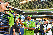 QB Russell Wilson of the Seattle Seahawks signs autographs before the a MLS soccer match between the LA Galaxy and the Seattle Sounders on Saturday, September 1, 2019, in Seattle, Washington. (Alika Jenner/Image of Sport via AP)