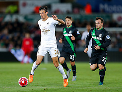 Jack Cork of Swansea City is challenged by Xherdan Shaqiri of Stoke City - Mandatory byline: Rogan Thomson/JMP - 07966 386802 - 19/10/2015 - FOOTBALL - Liberty Stadium - Swansea, Wales - Swansea City v Stoke City - Barclays Premier League.
