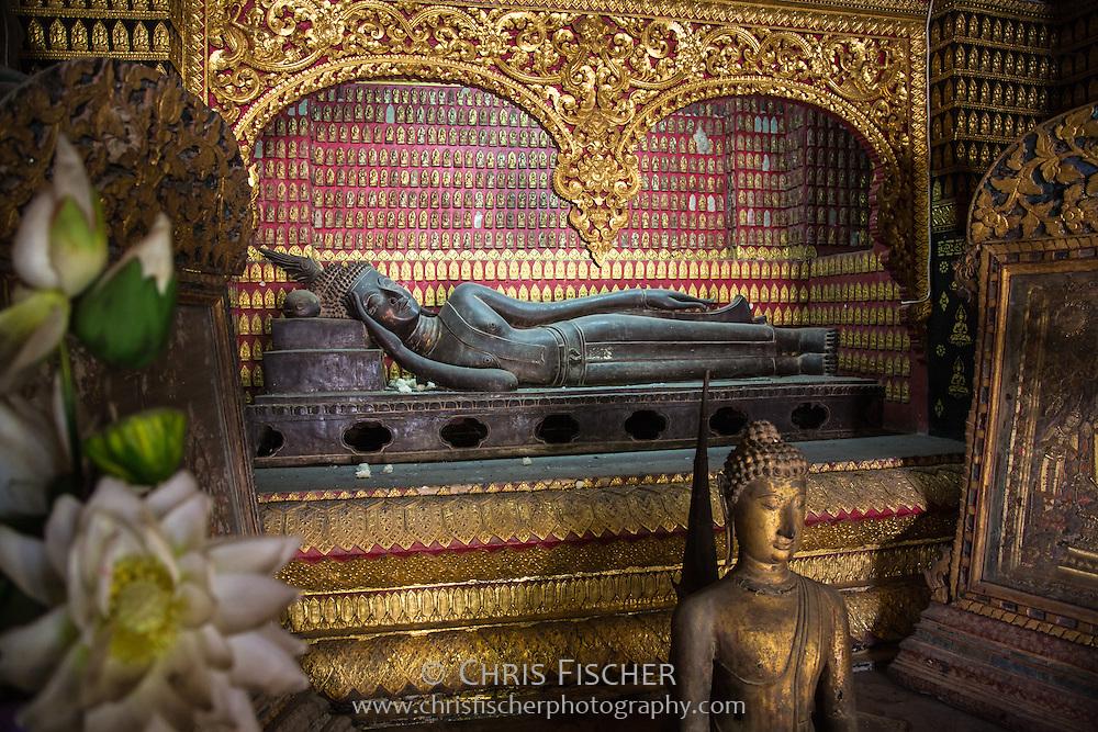 Recling Buddha Statue in the Reclining Buddha Shrine (Red Chapel) at Wat Xieng Thong (Golden City Temple), Luang Prabang, Laos.
