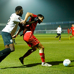 Hartlepool's defender Myles Anderson keeps Dover's forward Inih Effiong from the ball during the National League match between Dover Athletic FC and Hartlepool United FC at Crabble Stadium, Kent on 24 November 2018. Photo by Matt Bristow.