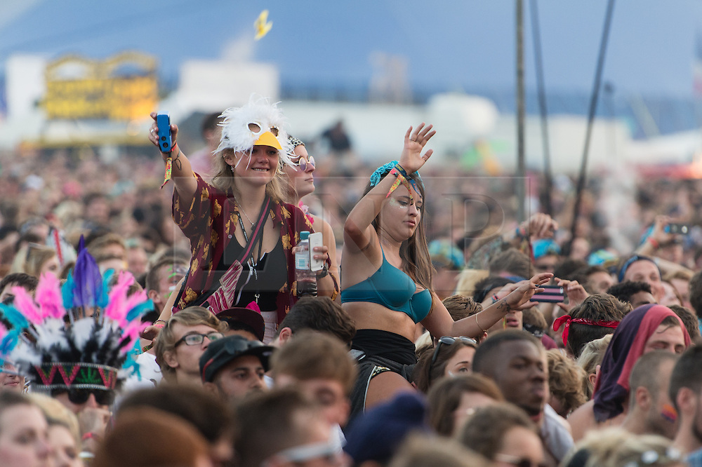 © Licensed to London News Pictures. 07/09/2014. Isle of Wight, UK. Bestival 2014 festival goers watch Major Lazer perform on the main stage of Bestival 2014 Day 4 Sunday the final day of the festival. This weekend's headliners include Chic featuring Nile Rodgers, Foals and Outcast.   Bestival is a four-day music festival held at the Robin Hill country park on the Isle of Wight, England. It has been held annually in late summer since 2004.    Photo credit : Richard Isaac/LNP