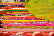 Piles of colourful scarves for sale in the Sardar Market in Jodhpur, Rajasthan, India