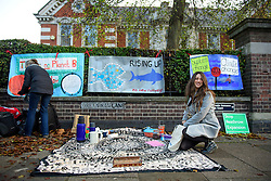 © Licensed to London News Pictures. 22/12/2016. London, UK. Protestor JOANNA BODIMEADE helps  set up a picnic area outside Ealing Magistrates Court in London, where 15 protestors are charged with Wilful Obstruction of the Highway after blocking an access road to Heathrow on November 18, 2016. Photo credit: Ben Cawthra/LNP