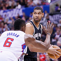 18 February 2014: San Antonio Spurs power forward Tim Duncan (21) looks to pass over Los Angeles Clippers center DeAndre Jordan (6) during the San Antonio Spurs 113-103 victory over the Los Angeles Clippers at the Staples Center, Los Angeles, California, USA.