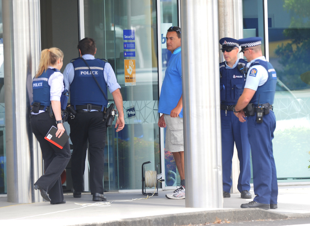 Police evacuated the area around the Manukau branch of the BNZ bank after a suspect parcel was found in the building, Auckland, New Zealand, Friday, January 24, 2014. A bomb squad member checked the building. Credit:SNPA / Ross Setford