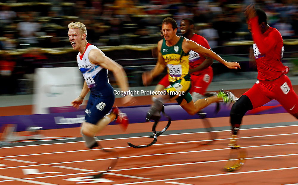 Jonnie Peacock (L) of Great Britain wins gold in the men's 100m - T44 final at the Olympic Stadium during the London 2012 Paralympic Games, London, Britain, 06 September 2012.  EPA/KERIM OKTEN