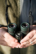 Captain Joe's all important binoculars for bird-watching and guiding.