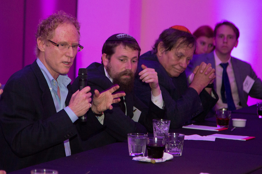FEBRUARY 5, 2015----MIAMI, FLORIDA---PHOTO BY ANGEL VALENTIN<br /> Clifford M. Stein, left, President of Savitar Realty Advisors, talks about his business next to Rabbi Chaim Lipskar, second from left, during a roundtable discussion on Real Estate and investment opportunities at the Rok Family Shul Chabad Downtown Jewish Center in the Brickell area of Miami event. The center hosted was attended by young Jews, mostly non-Orthodox.