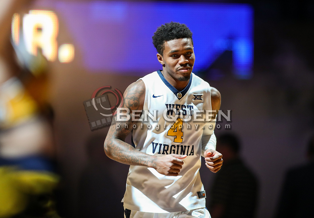Dec 20, 2017; Morgantown, WV, USA; West Virginia Mountaineers guard Daxter Miles Jr. (4) runs onto the court before their game against the Coppin State Eagles at WVU Coliseum. Mandatory Credit: Ben Queen-USA TODAY Sports