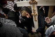Eastern European Orthodox Christians hold wooden crosses as they make their way through the Holy Sepluchre Church in Jerusalem's Old City during a Good Friday procession on April 2, 2010.