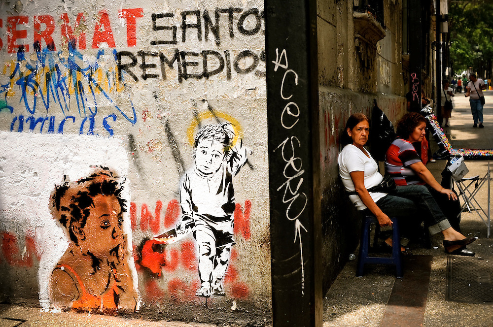 A stencil that criticizes Colombian former defense minister Juan Manuel Santos painted by Carlos Zerpa, 26, of the Guerrilla Communications Collective in Caracas, Venezuela. The Venezuelan government commissions collectives of graffiti artists to plaster the city in murals and stencils that promote the Bolivarian revolution and the political agenda of President Hugo Chavez.