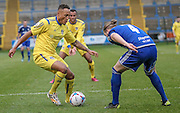 James Hurst (Guiseley) runs at Kingsley James (Halifax) inside the Halifax box during the Conference Premier League match between FC Halifax Town and Guiseley at the Shay, Halifax, United Kingdom on 5 December 2015. Photo by Mark P Doherty.