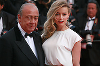 Fawaz Gruosi and Amber Heard at the Two Days, One Night (Deux Jours, Une Nuit) gala screening red carpet at the 67th Cannes Film Festival France. Tuesday 20th May 2014 in Cannes Film Festival, France.