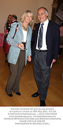 MICHAEL HOWARD MP and his wife SANDRA at a party in London on 28th May 2003.PJZ 235