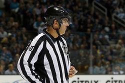 Dec 3, 2011; San Jose, CA, USA; NHL linesman Thor Nelson (80) before a face off between the San Jose Sharks and the Florida Panthers during the first period at HP Pavilion. Florida defeated San Jose 5-3. Mandatory Credit: Jason O. Watson-US PRESSWIRE