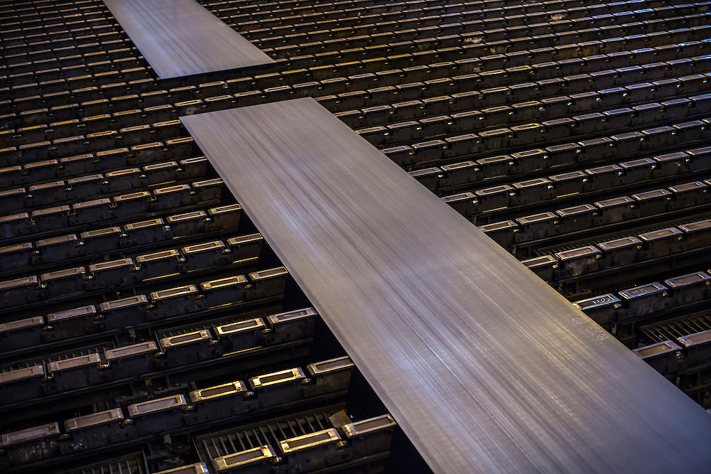 Freshly rolled sheets of steel come off the manufacturing line at the Azovstal Iron and Steel Works on Friday, March 18, 2016 in Mariupol, Ukraine.