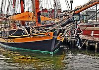 "Crewmen working on the ropes of the Sailing Schooner ""Pride of Baltimore 11"" in Baltimore's Inner Harbor."