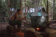 El Diamante, Meta, Colombia - 16.09.2016        <br /> <br /> Kitchen area of the guerilla camp during the 10th conference of the marxist FARC-EP in El Diamante, a Guerilla controlled area in the Colombian district Meta. Few days ahead of the peace contract passing after 52 years of war with the Colombian Governement wants the FARC decide on the 7-days long conferce their transformation into a unarmed political organization. <br /> <br /> Kueche des Guerilla-Camps zur zehnten Konferenz der marxistischen FARC-EP in El Diamante, einem von der Guerilla kontrollierten Gebiet im kolumbianischen Region Meta. Wenige Tage vor der geplanten Verabschiedung eines Friedensvertrags nach 52 Jahren Krieg mit der kolumbianischen Regierung will die FARC auf ihrer sieben taegigen Konferenz die Umwandlung in eine unbewaffneten politischen Organisation beschlie&szlig;en. <br />  <br /> Photo: Bjoern Kietzmann