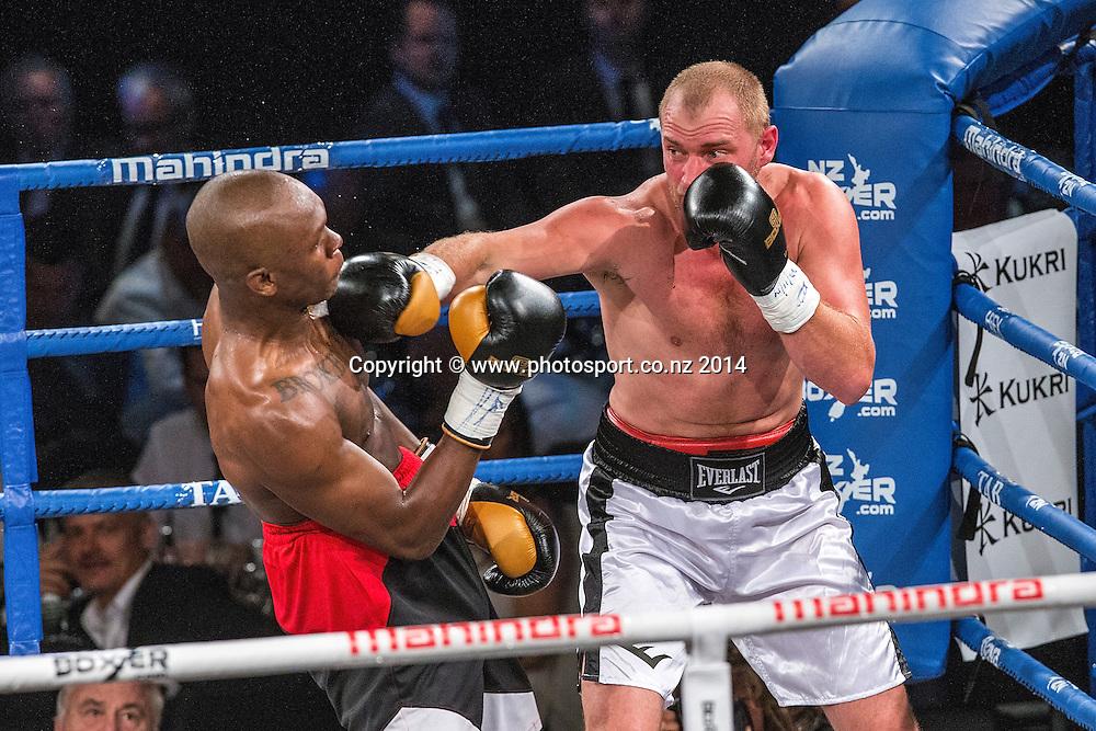 Israel`Style Bender`Adesanya (L) fights Daniel Ammann in the Mahindra Super 8 Fight Night, North Shore Events Centre, Auckland, New Zealand, Saturday, November 22, 2014. Photo: David Rowland/Photosport