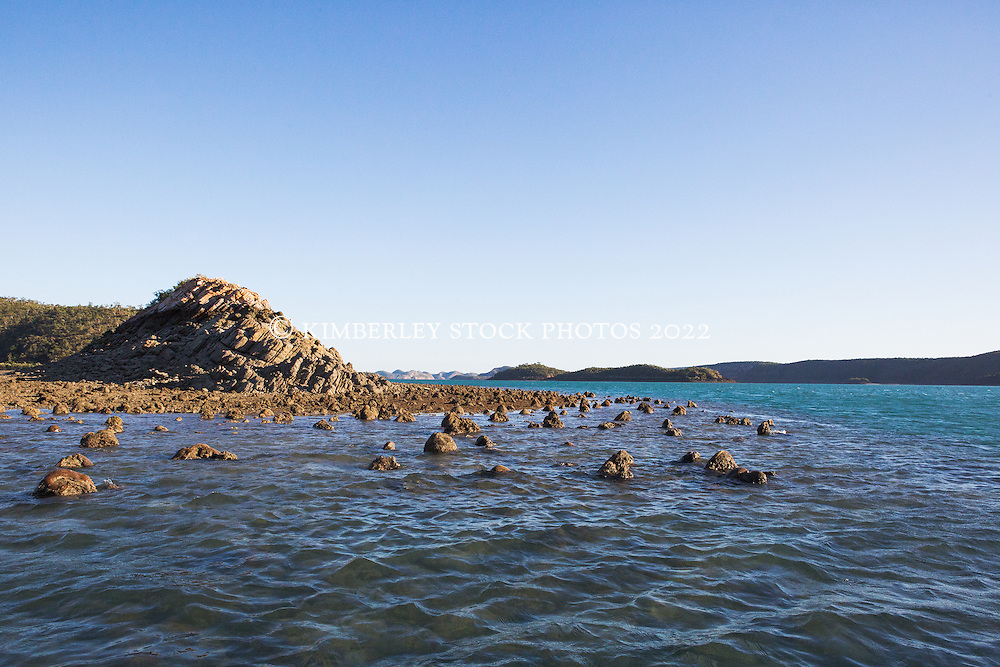Coral lumps emerge from a fringing reef in Dugong Bay on the Kimberley coast.