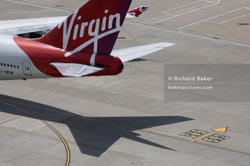 Aerial view (from control tower) of Virgin Atlantic airliner's tail at London Heathrow airport.