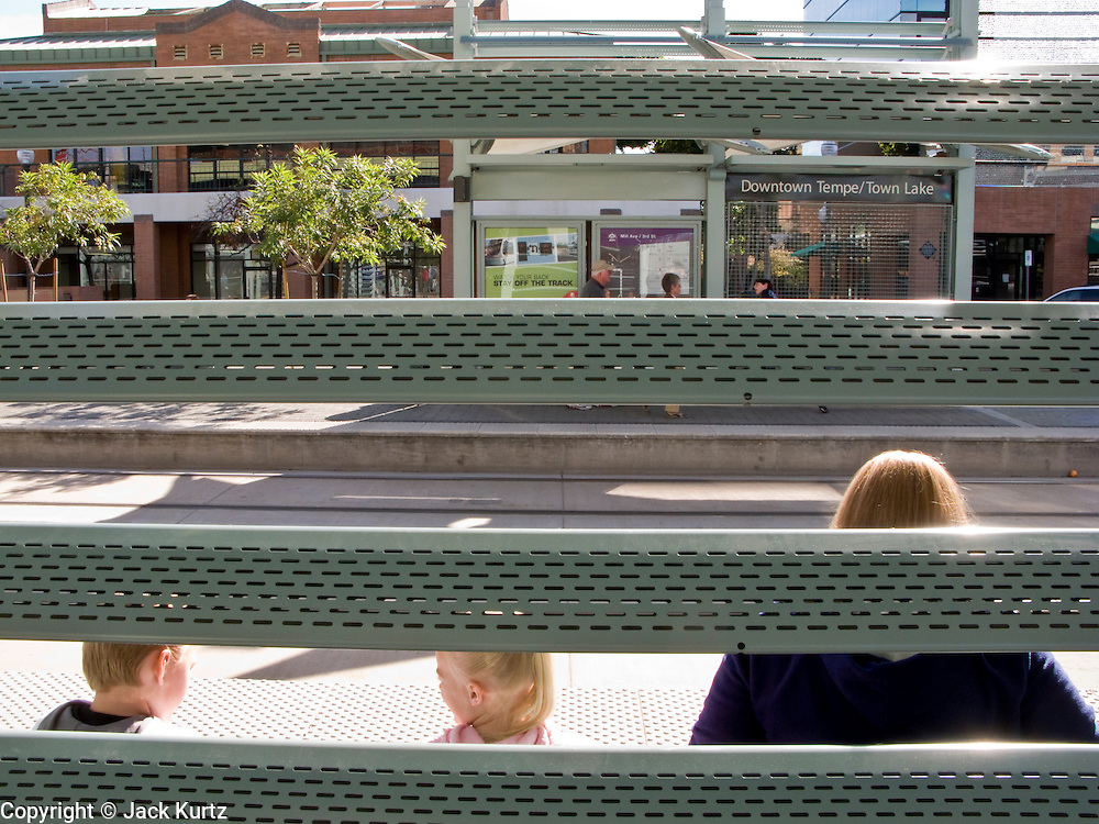 11 JANUARY 2009 -- PHOENIX, AZ: Riders wait to board the new METRO light rail in Tempe to ride to Phoenix. The METRO started running on Dec 27, 2008, three weeks after the grand opening weekend trains are still crowded.  PHOTO BY JACK KURTZ