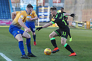 Forest Green Rovers George Williams(11) takes on Mansfield Town's Matt Preston(4) during the EFL Sky Bet League 2 match between Mansfield Town and Forest Green Rovers at the One Call Stadium, Mansfield, England on 23 February 2019.
