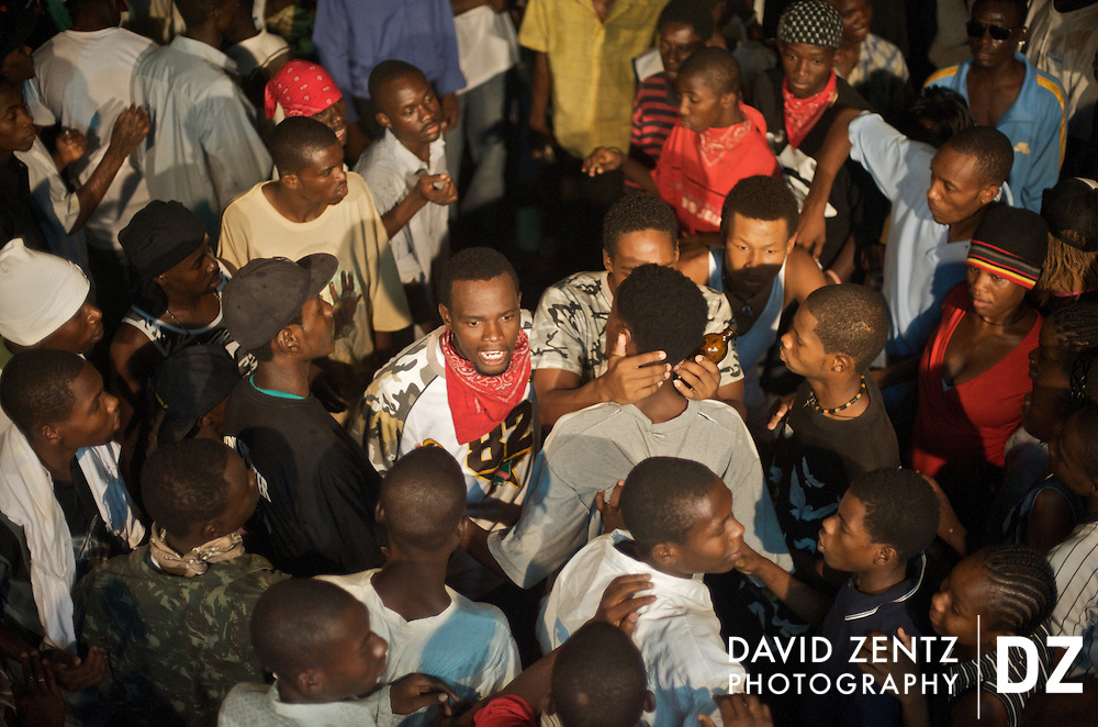 A fight breaks out between rival groups duiring a ti sourit, an all-night block party in Port-au-Prince, Haiti  on July 13, 2008. The parties feature a heavy dose of Rap Kreyol and are popular with young hip-hop enthusiasts.