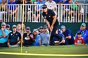 Camilo Villegas watches his putt on the eighteenth hole during the second round of The Barclays Championship held at Plainfield Country Club in Edison, New Jersey on August 28.