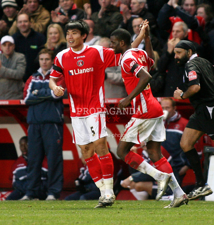 London, England - Saturday, January 12th, 2008:  Charlton Athletic's Zheng Zhi celebrates scoring the fourth goal with Izale McLeod against Blackpool during the League Championship match at The Valley. (Pic by Chris Ratcliffe/Propaganda)