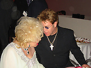 Elizabeth Taylor and Elton John..**EXCLUSIVE**.2003 amFAR Cinema Against Aids-Cannes Film Festival.Moulin de Mougins..Thursday, May 22, 2003..Mougins, France..Photo By Celebrityvibe.com.To license this image please call (212) 410 5354; or .Email: CelebrityVibe@gmail.com ; .website: www.CelebrityVibe.com.**EXCLUSIVE**