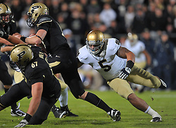 Linebacker Manti Te'o (5) gets a hand on Boilermakers QB Caleb TerBush (19) in the first quarter.