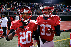 Runner-backs Nasir Bonner (#20) and David Williams(#33) pose for a shot...PIAA Public School League Finals, November 11, 2012 - Benjamin L. Johnson Memorial Stadium, Philadelphia, PA, USA: Imhotep Panthers star-Running back David Williams (#33) leads his team to the finals. David Williams (#33) now playing for the Imhotep Panthers transferred from West Catholic, together with Head Coach Albie Crosby. ..Imhotep takes the 2012 PIAA 12 district championship with a 40-8 win over the West Catholic Burrs. Talented Running back David Williams (#33) has a big hand in course of the evening. ..( Nikon D800 | ISO 8000 | Sigma 24-70mm | F/3.5 | 1/200 ).Available stadium light, high ISO shot in 36mp, 14bit RAW, RGB. Basic contrast/levels in Apple Aperture.