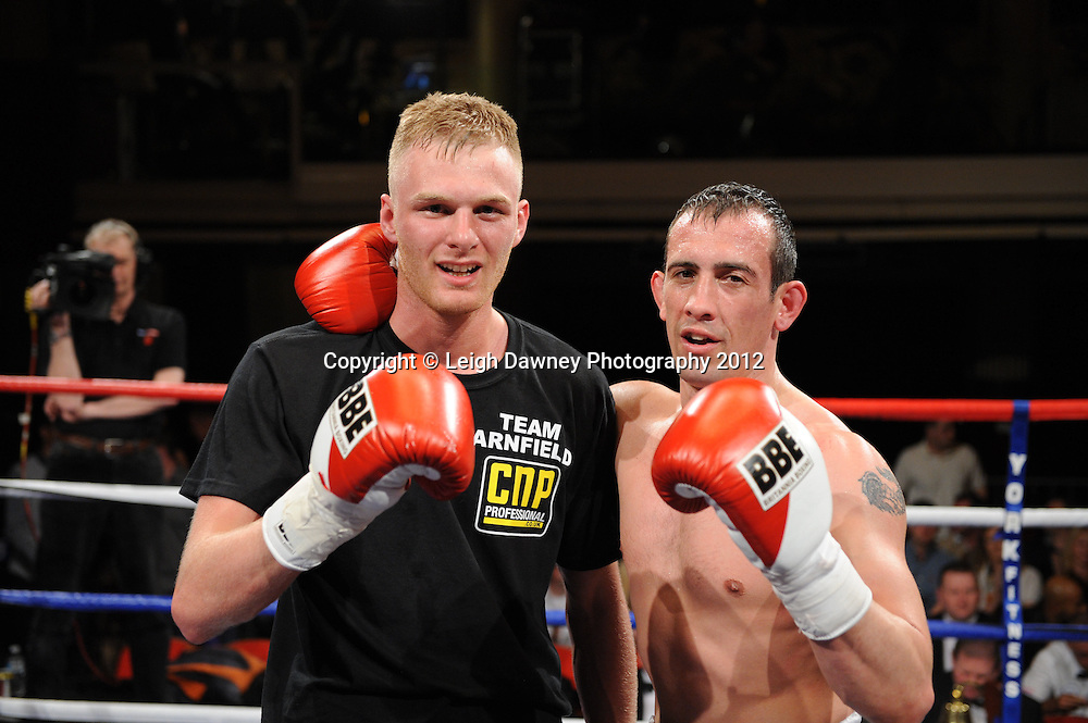 Jack Arnfield (left) defeats Kevin McCauley in a Light Middleweight  contest at The Winter Gardens, Blackpool on the 31st March 2012. Frank Maloney and Steve Wood VIP Promotions. © Leigh Dawney Photography 2012.
