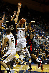 Jan 14, 2012; Berkeley CA, USA;  California Golden Bears guard Justin Cobbs (1) is defended by Utah Utes center Jason Washburn (42) during the second half at Haas Pavilion. California defeated Utah 81-45. Mandatory Credit: Jason O. Watson-US PRESSWIRE