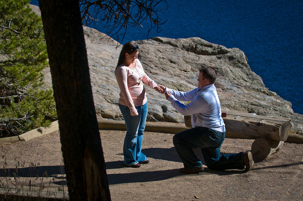 Jason asks Stormi for her hand in marriage during a surprise proposal on the shore of Bear Lake in Rocky Mountain National Park near Estes Park, Colorado, on Wednesday, Oct. 19, 2011...Photo by Joshua Lawton /  / Joshua & Co. Photography..www.joshuacophotography.com