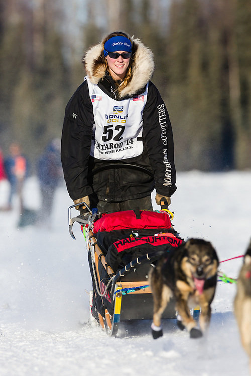 Musher Anna Berington competing in the 42nd Iditarod Trail Sled Dog Race on Long Lake after leaving the restart on Willow Lake in Southcentral Alaska.  Afternoon. Winter.
