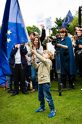 Pictured: Finlay Mair (5)<br /> Thousands of people gathered outside the Scottish Parliament to demonstrate for Scotland to remain part of EU. Young and old gathered in support of the European Movement Edinburgh  whoorganised the event inthe wake of the vote to leave<br /> <br /> <br /> Ger Harley | EEm 29 June 2016