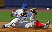 New York Mets shortstop, Jose Reyes bobbles the ball allowing Houston Astros Adam Everett to steal second safely during a baseball game, July 23, 2006 in New York.