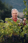 Napa Valley, California. Businessman Donald Hess, owner of The Hess Collection Winery in the Mt. Veeder region of Napa Valley.  Photographed with 70-year-old Cabernet Sauvignon vines. MODEL RELEASED.