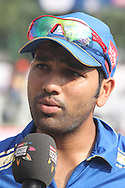 Mumbai Indians captain Rohit Sharma after the toss during match 19 of the Karbonn Smart Champions League T20 between the Perth Scorchers and the Mumbai Indians held at the Feroz Shah Kotla Stadium, Delhi on the 2nd October 2013<br /> <br /> <br /> Photo by Shaun Roy-CLT20-SPORTZPICS <br /> <br /> Use of this image is subject to the terms and conditions as outlined by the CLT20. These terms can be found by following this link:<br /> <br /> http://sportzpics.photoshelter.com/image/I0000NmDchxxGVv4