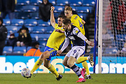 Birmingham City defender Harlee Dean (12) battles for possession with Millwall forward Tom Bradshaw (9) during the EFL Sky Bet Championship match between Millwall and Birmingham City at The Den, London, England on 26 February 2020.
