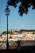 View of São Jorge Castle from the Miradouro de São Pedro de Alcantara in Lisbon's Barrio Alto.